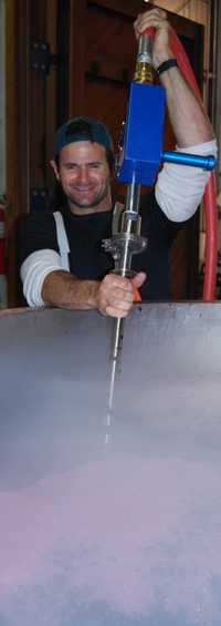 Todd uses a PulseAir system to aerate a two ton fermenter of estate pinot noir, by Anne Amie Vineyards, Oregon